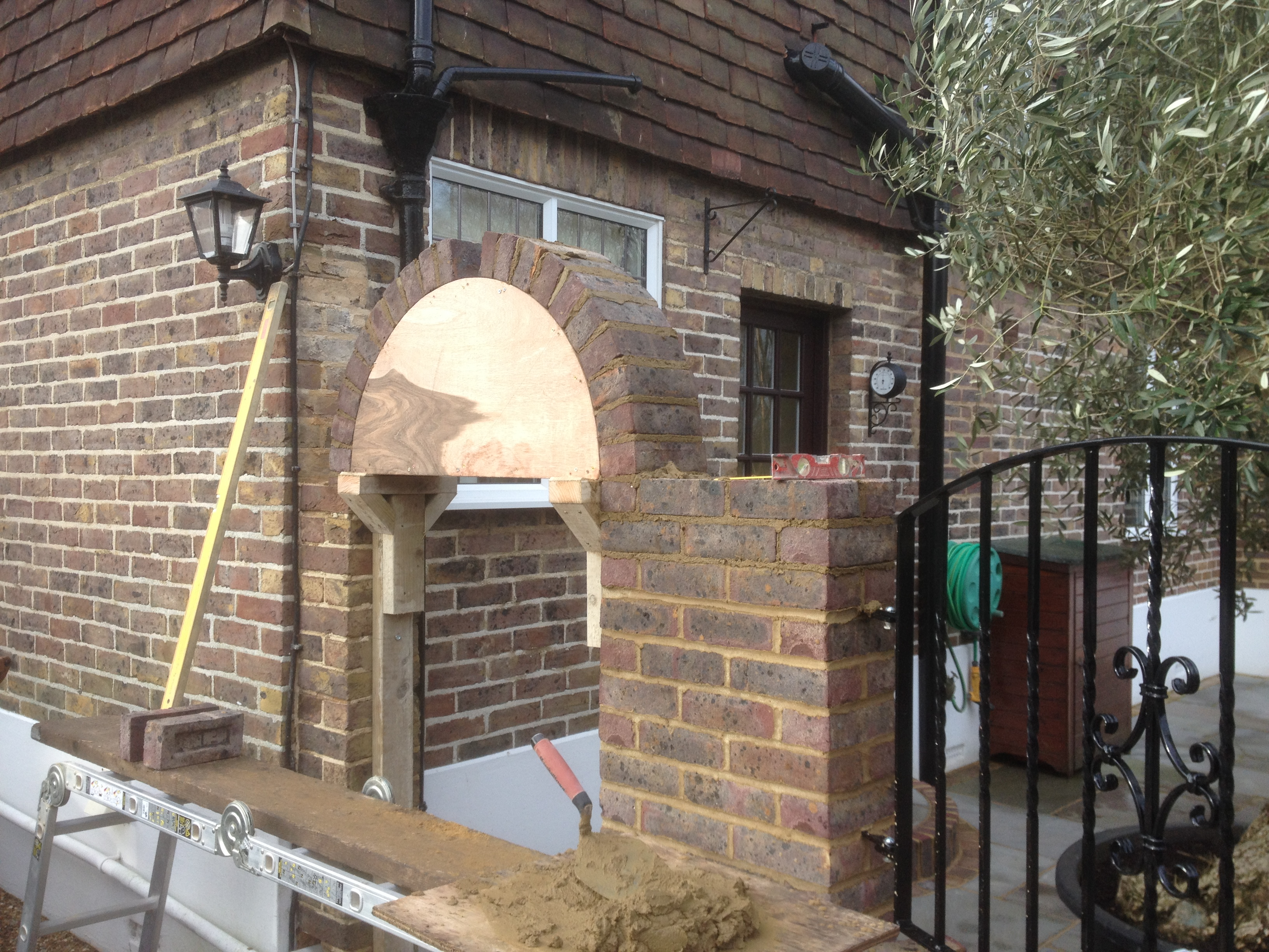 horsmonden has construction cured iron formwork decorative under brickwork project supports until uk timber stratalandscapes panels brick the wall img co with it wrought decor archway